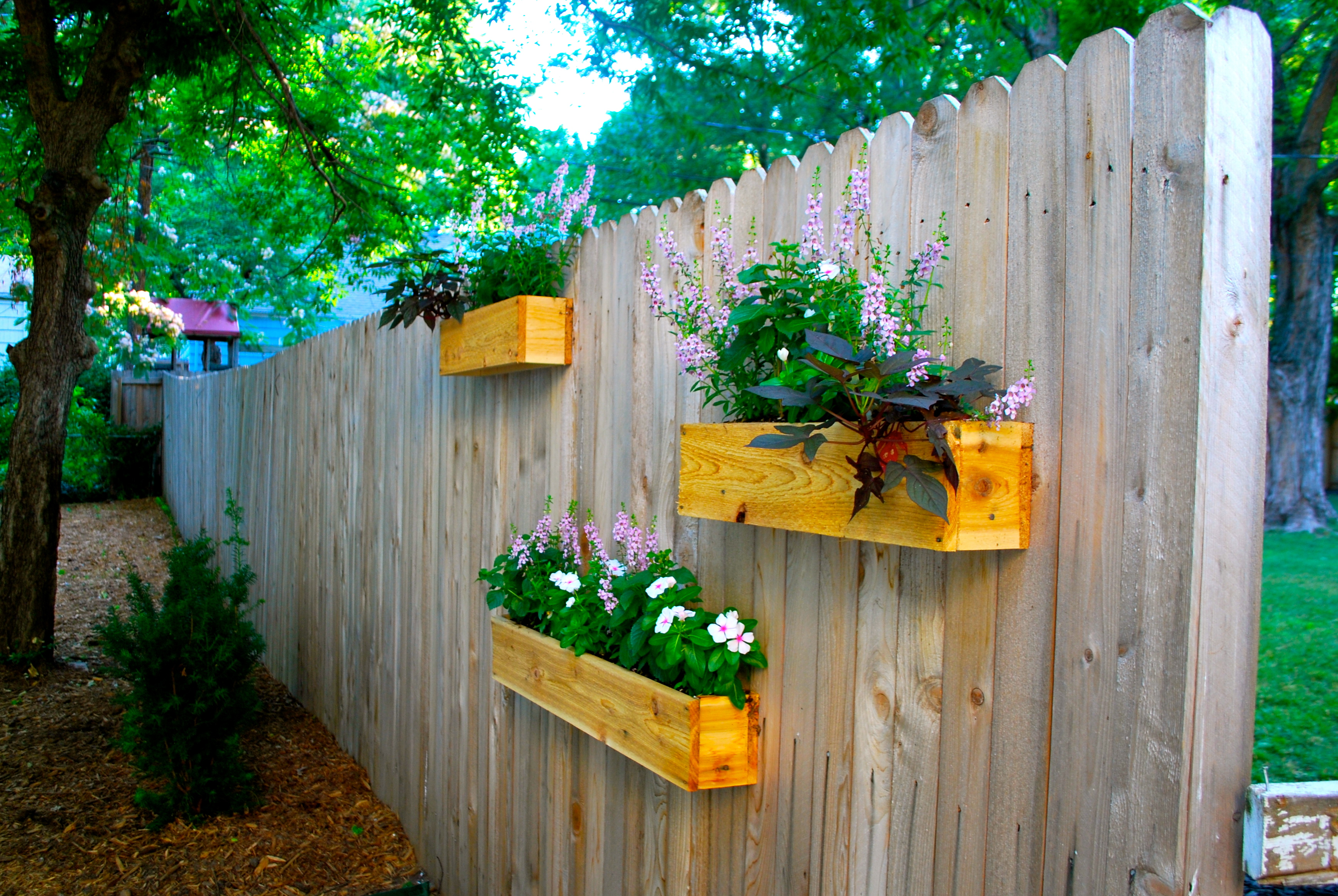 Yard update and diy cedar planter boxes the suburban - Flower pots to hang on fence ...